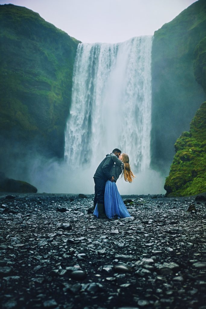 Victoria Yore And Terrence Drysdale Kissing at Skogafoss Waterfall In Iceland