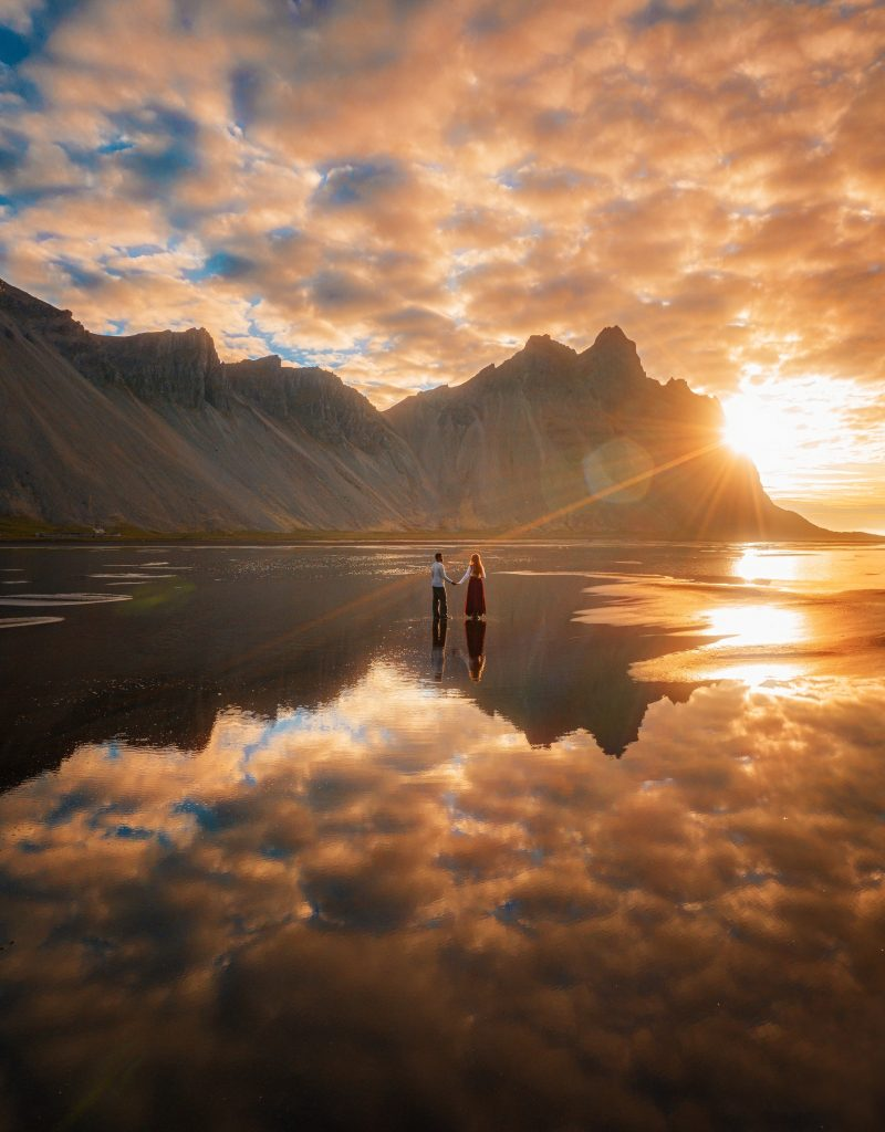 couple at sunrise at Stokksness in Iceland