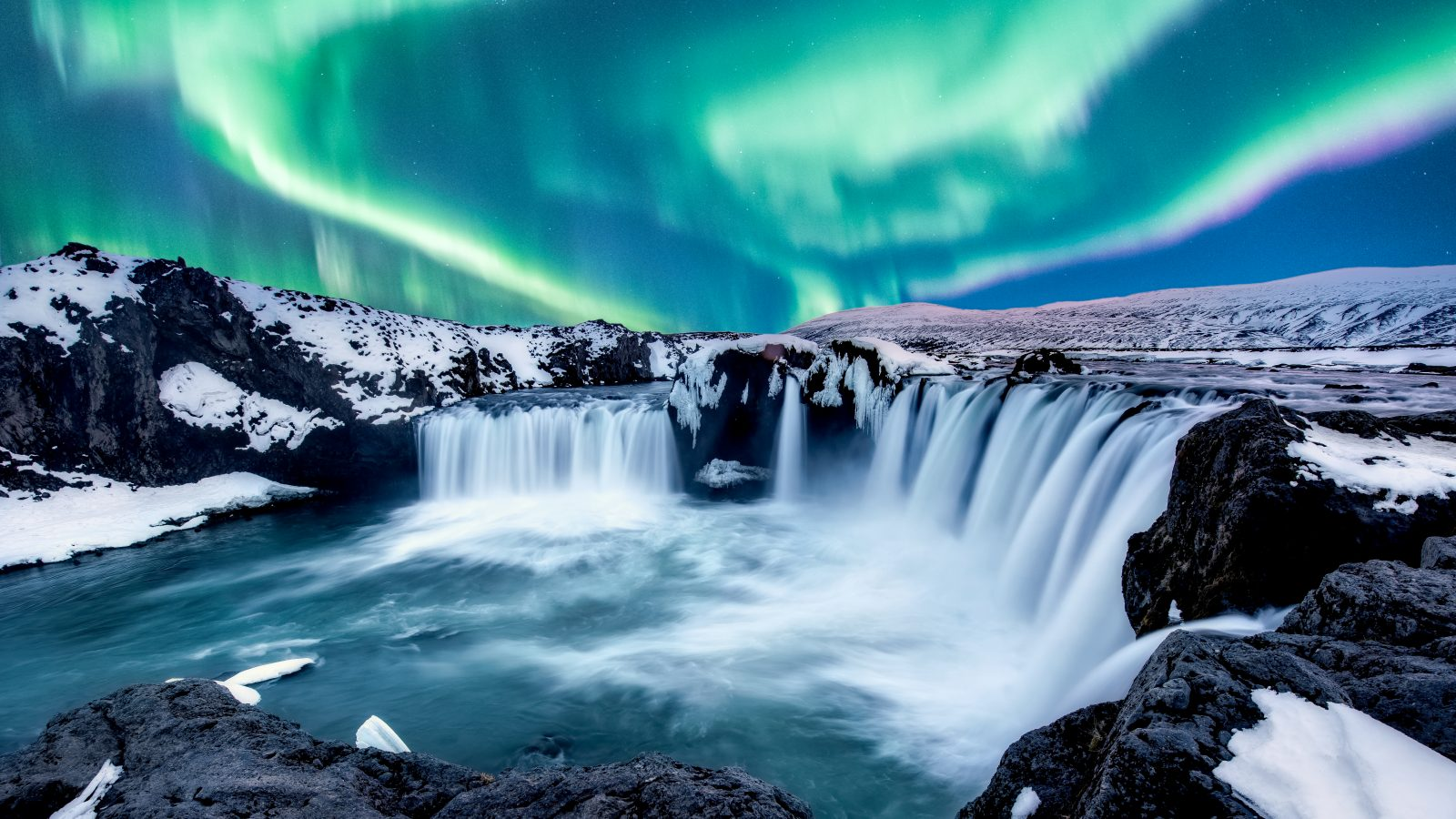 godafoss waterfall in iceland with northern lights