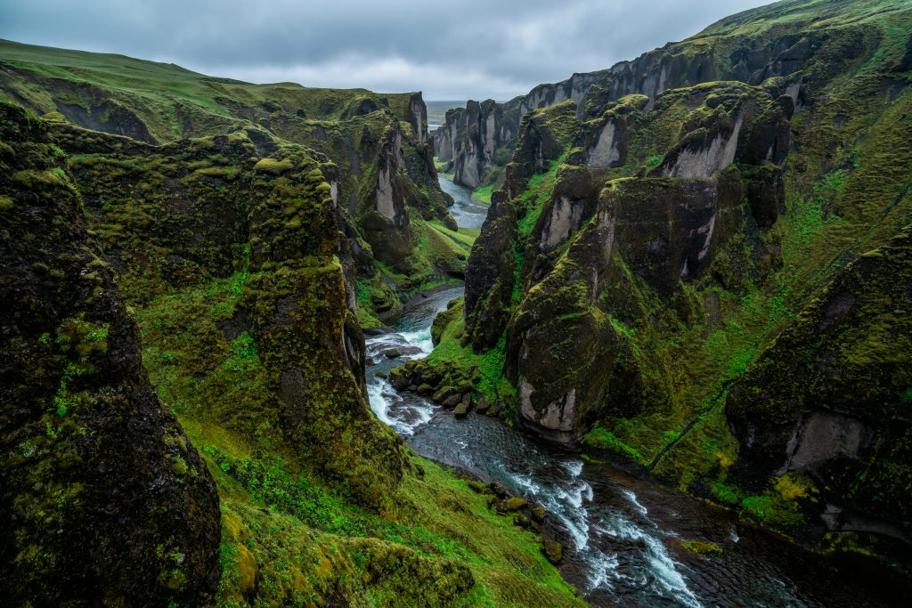 river flowing through greenery-laden canyon best things to do in Iceland