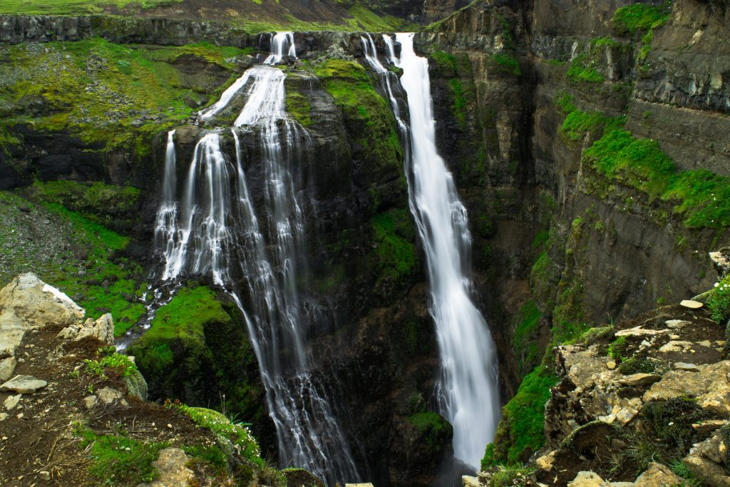 split waterfall cascading into canyon best things to do in Iceland