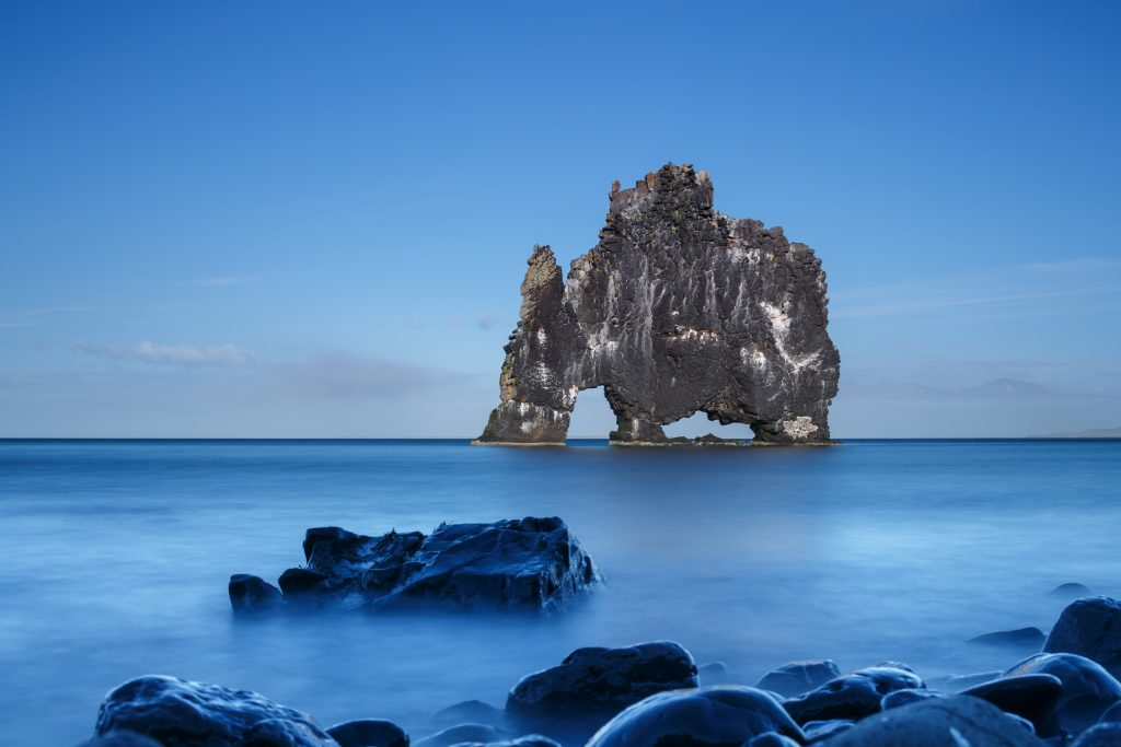 intriguing gray rock formation in the ocean best things to do in Iceland