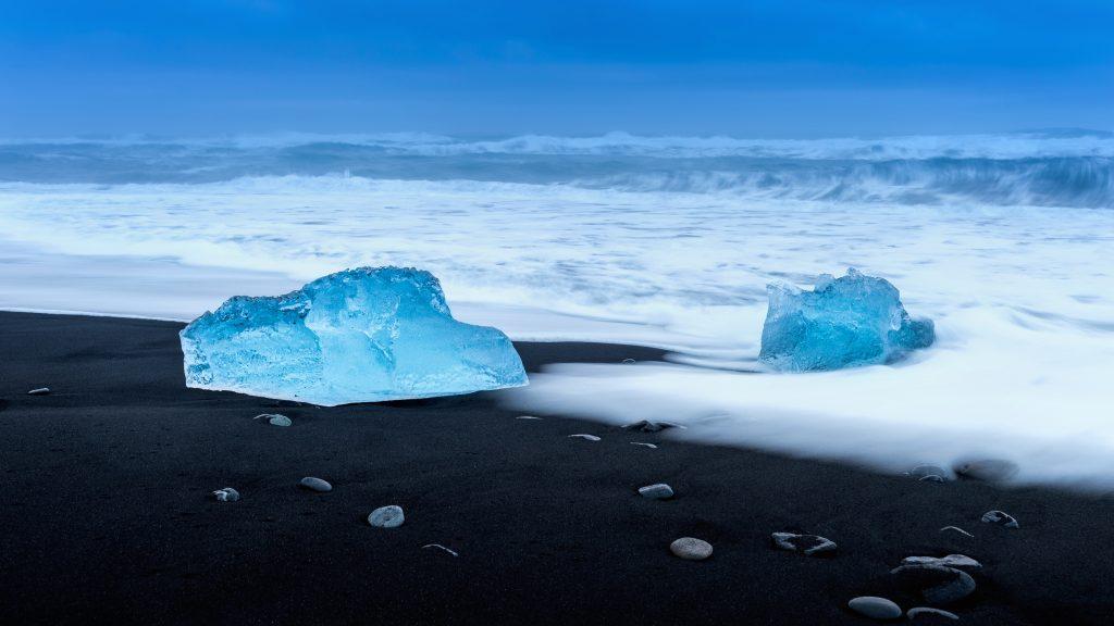 chunks of ice on diamond black sand beach