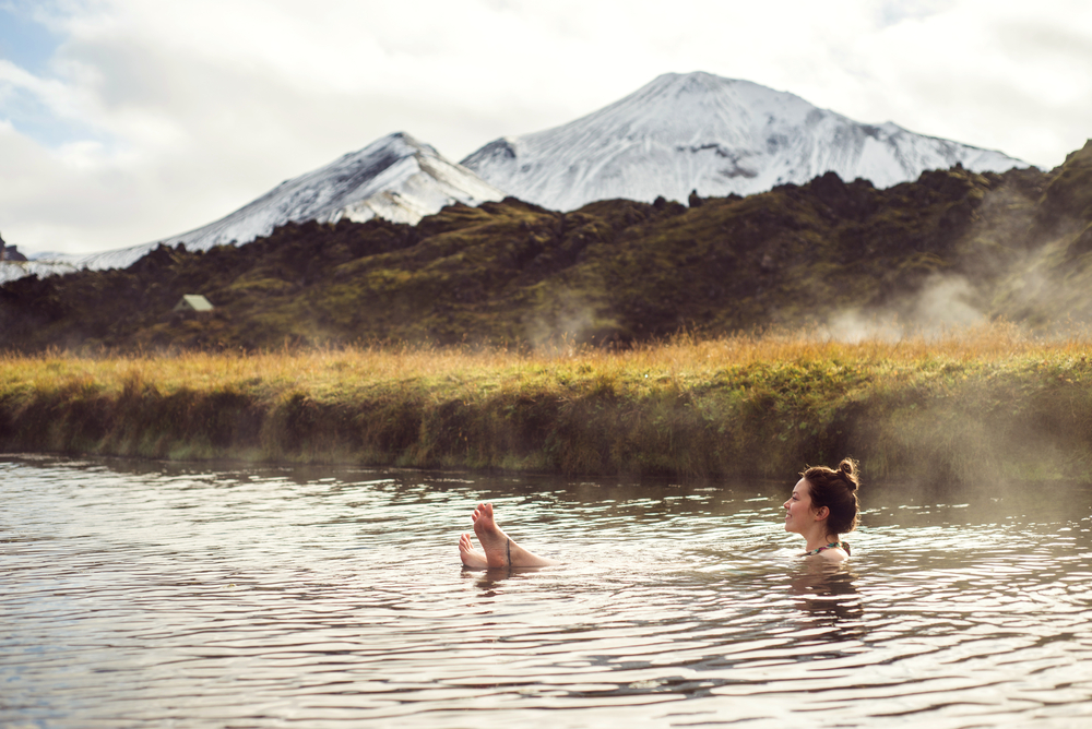 photo of a women in Landmannalaugar, a natural hot bath in one of the national parks in iceland