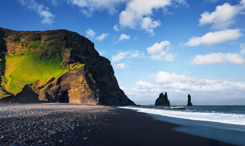 Photo of Reynisfjara Beach which is one of the amazing beaches in Iceland and it is located close to Vik.