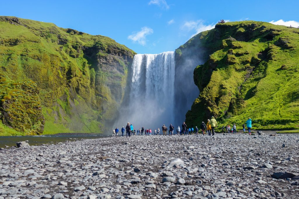 Photo of a guided tour at Skogafoss waterfall in Iceland.