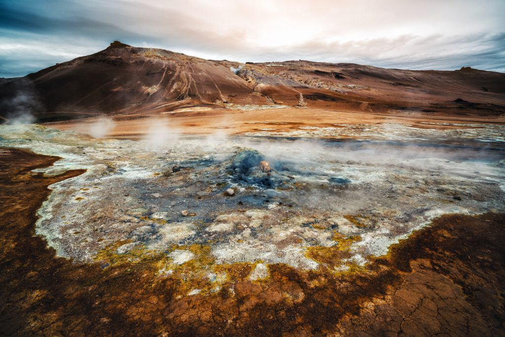 Photo of Hverir which is a geothermal spring that is located at the foot of Namafjall Mountain in Iceland. It is one of the Game of Thrones Iceland shooting locations.