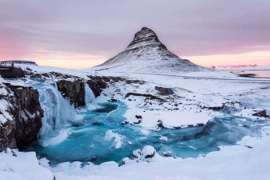 Photo of snow covered Kirkjufell Mountain located in Iceland.