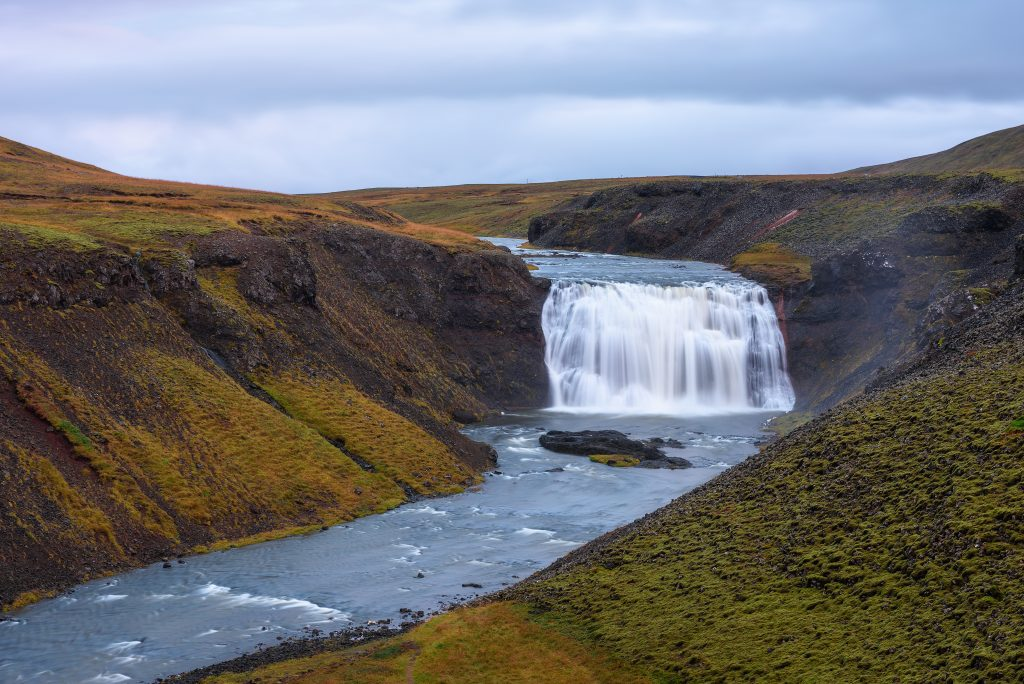 Photo of Þórufoss which is a secluded waterfall in the Golden Circle in Iceland. It is a Game of Thrones Iceland filming location.