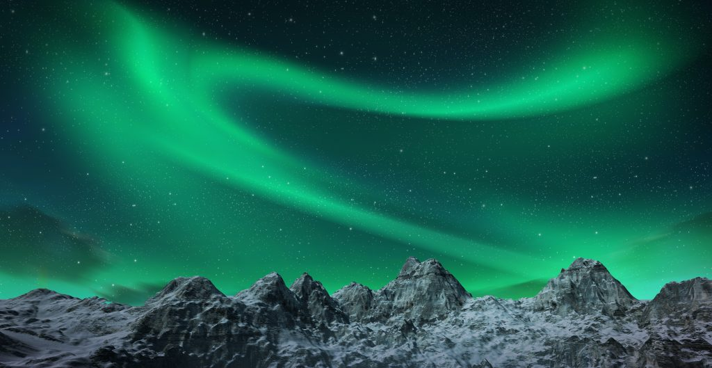 northern lights behind snow capped mountains Iceland northern lights tours