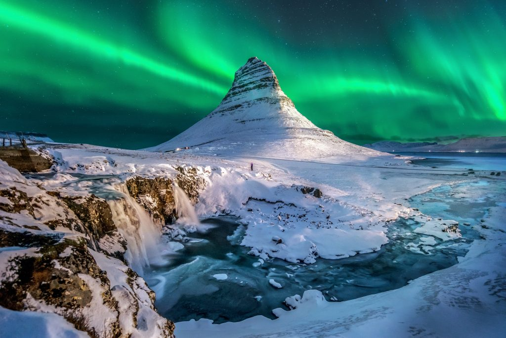 snowcapped kirkjufell mountain with northern lights