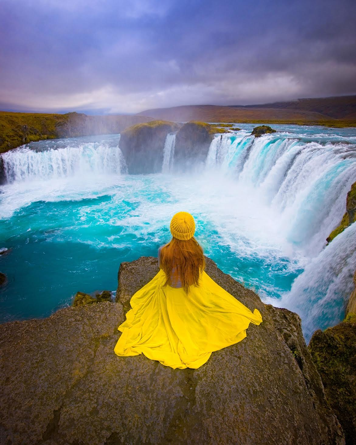 A woman sitting before one of the best waterfalls in Iceland