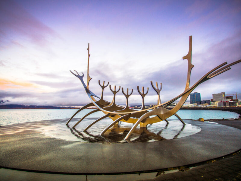 The Sun Voyager statue sits against a periwinkle sky.