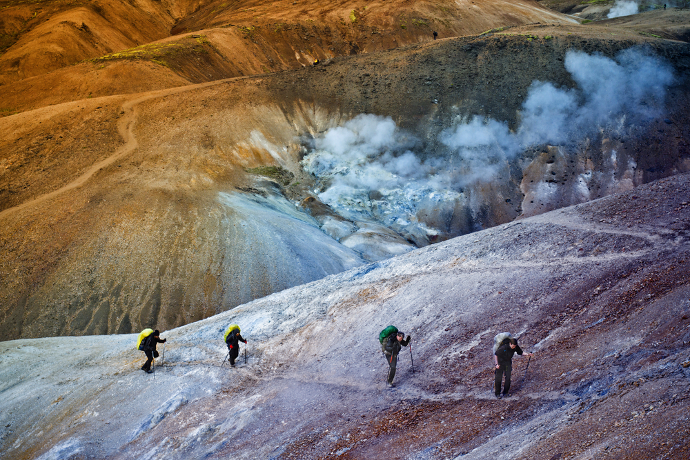 Photo of people hiking. If you want to avoid crowds, the low season is the best time to visit Iceland.