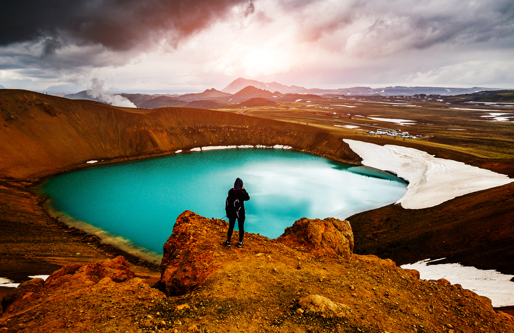 person at kerid crater during their tour in iceland