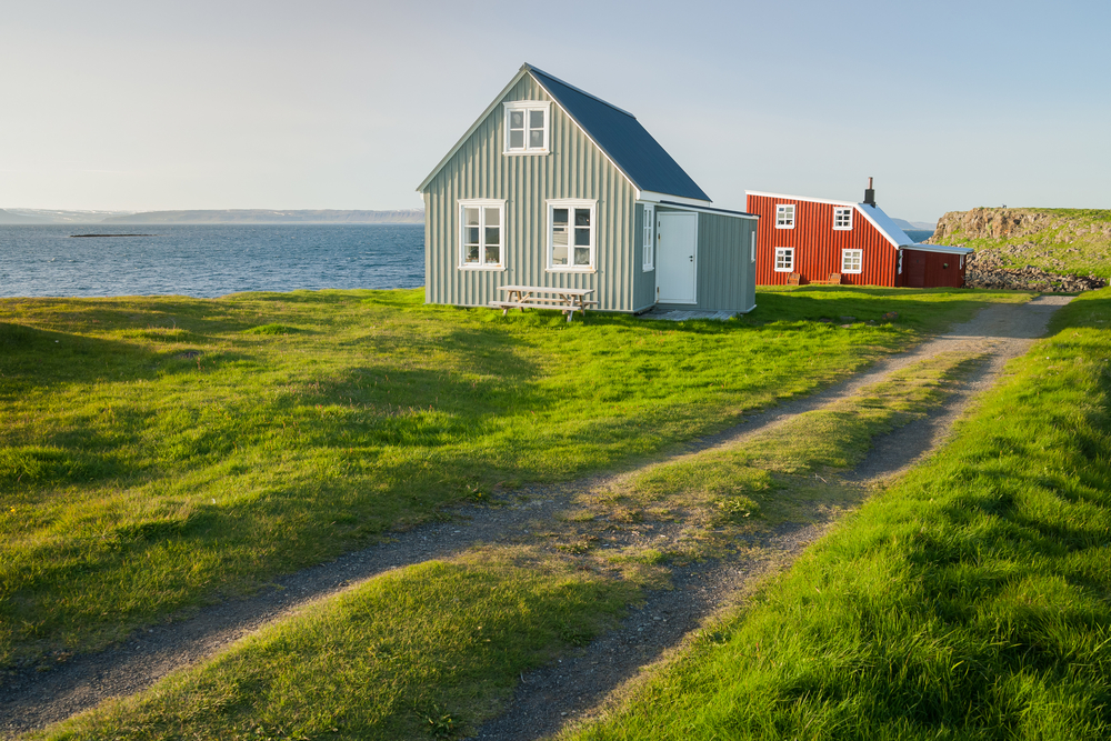 photo of traditional icelandic houses in Flatley island, which is located in one of the national parks in iceland