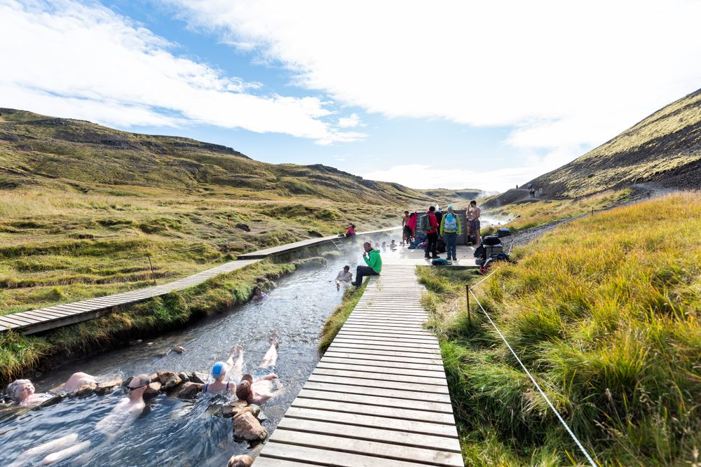 people bathing in the Reykjadalur hot springs along the Golden Circle Iceland