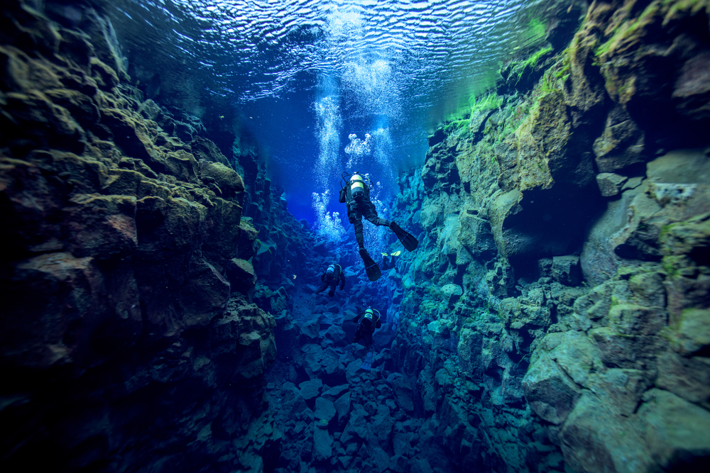 snorkeling the Silfra fissure at Thingvellir National Park along the Golden Circle Iceland