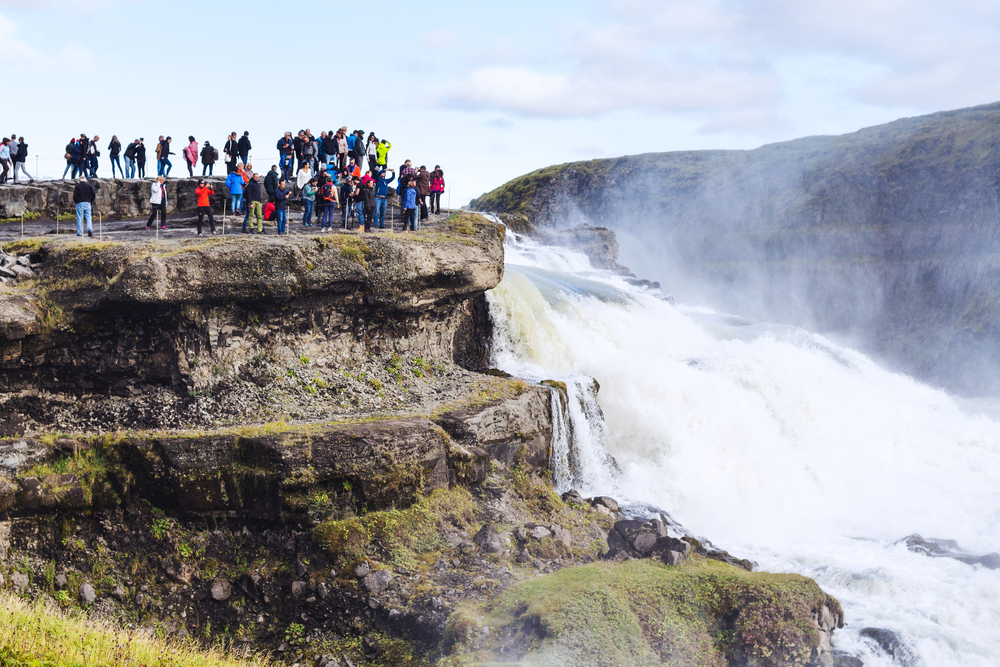 tourists at Gullfoss waterfall along the Golden Circle Iceland