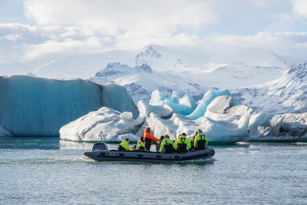 Zodiac Boat tour of jokulsarlon glacier lagoon. Boat close to icebergs.