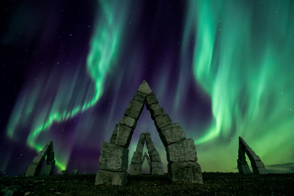 northern lights over arctic henge north iceland