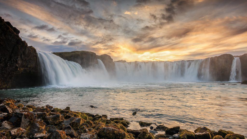 north iceland waterfall at sunset
