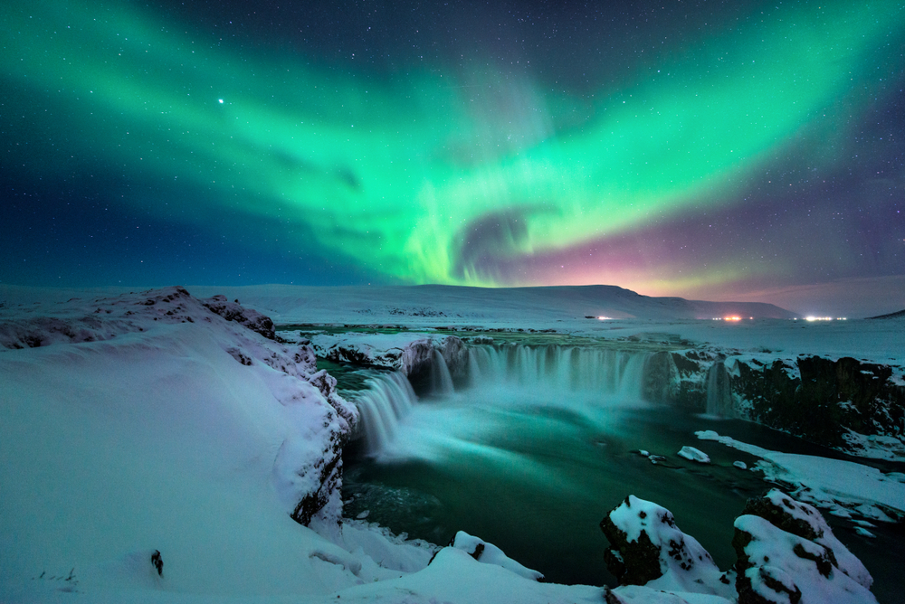 northern lights in Iceland over godafoss