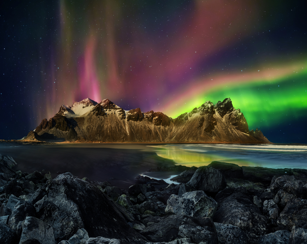 Perfect conditions and timing both include a clear sky and darkness to really see the vast colors of green and violet in the northern lights in Iceland.