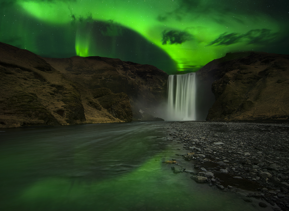The striking colors of the northern lights in Iceland are vivid and bold, particularly in their hues of green.