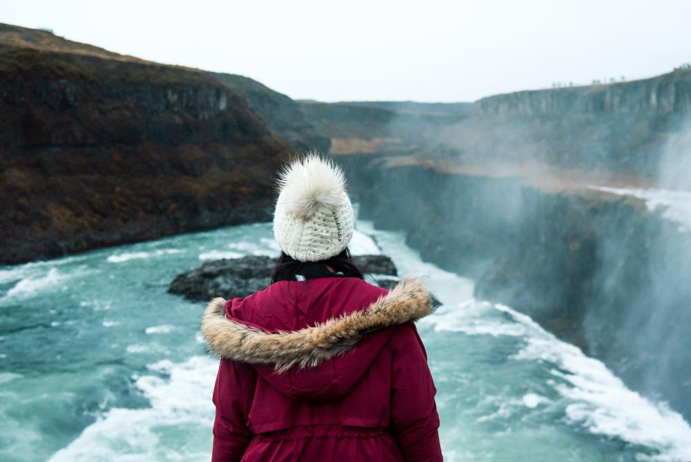 Female traveler at Gullfoss Falls in Iceland on Golden circle tours