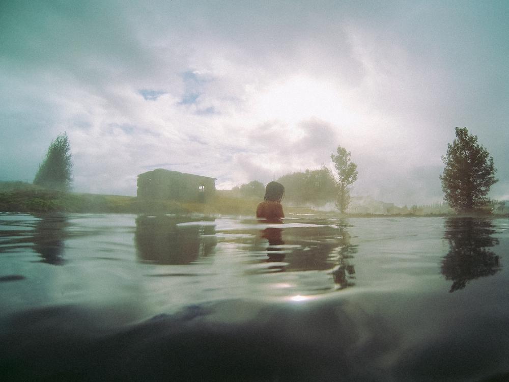 girls swimming in The Secret  Lagoon Iceland