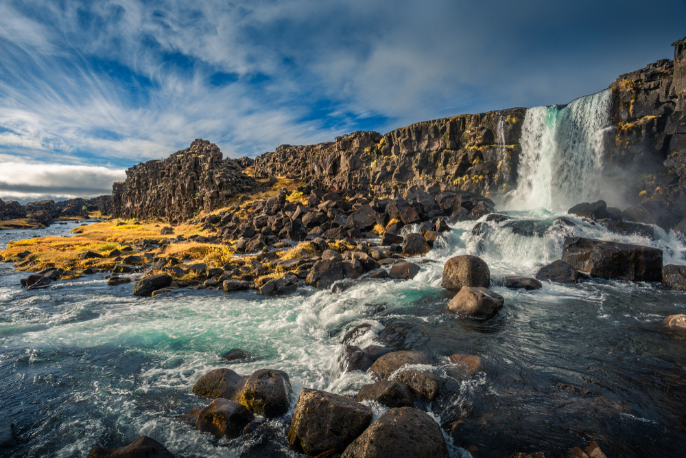 the stunning waterfall of thingvellir, one of the many national parks in iceland