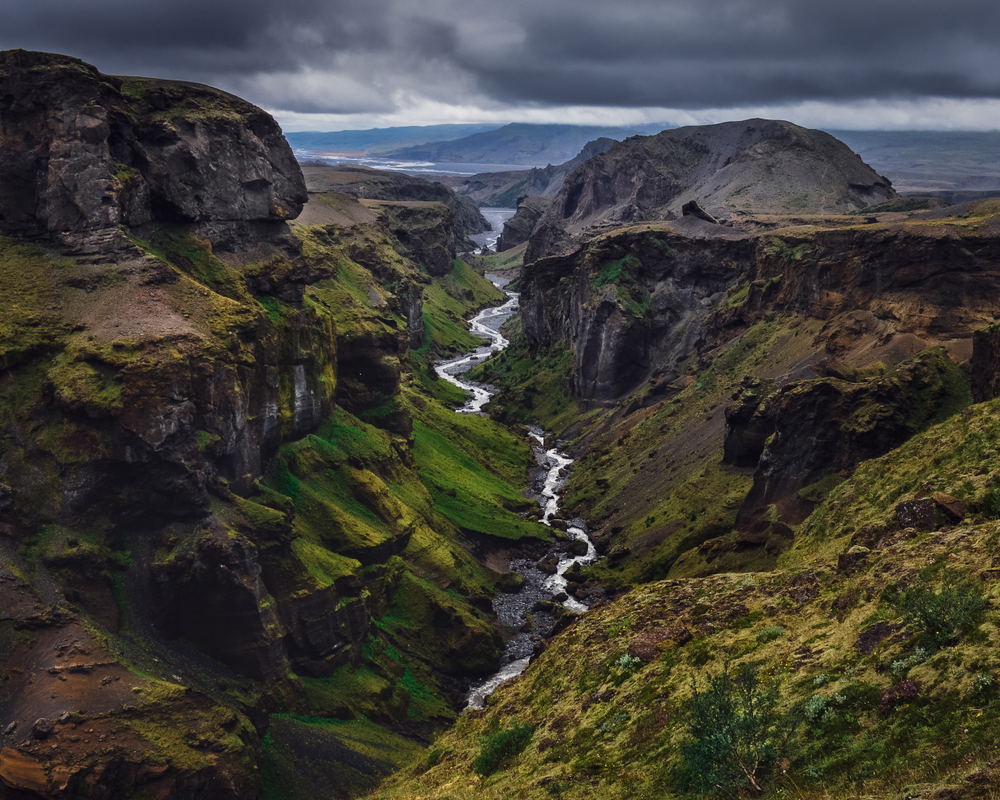 arial photo of Thorsmork national park in iceland. There is a winding river running between two valleys