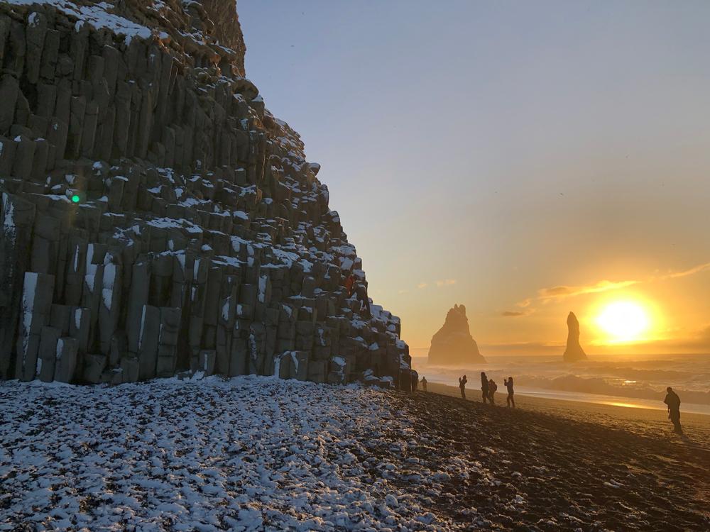 Reynisfjara black sand beach in Iceland in the winter at sunrise