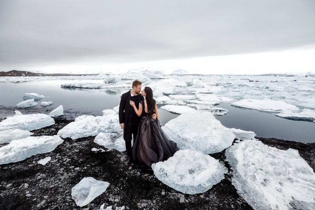 couple gazing at each other on the shores of a glacier lagoon Iceland wedding