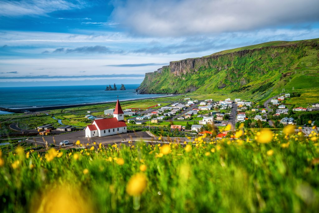 town by ocean and mountain with best airbnbs in iceland