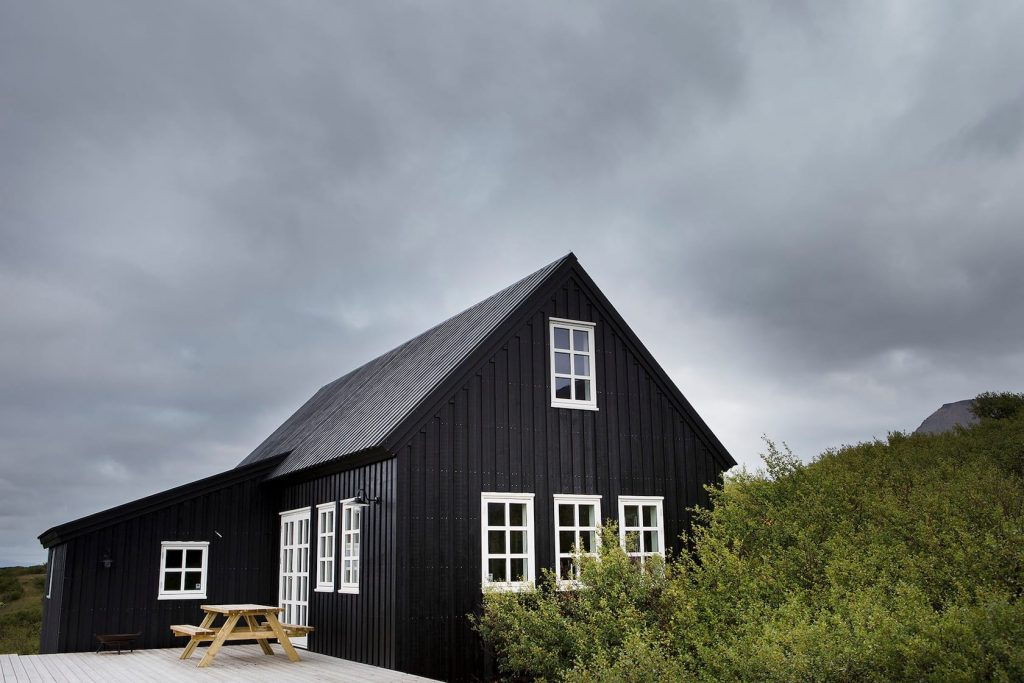 traditional black timber house airbnb in Iceland