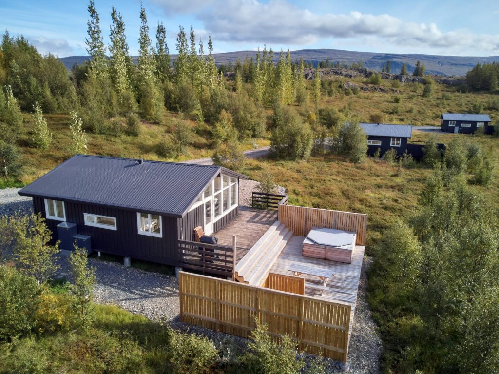black cottage with hot tub airbnb in iceland
