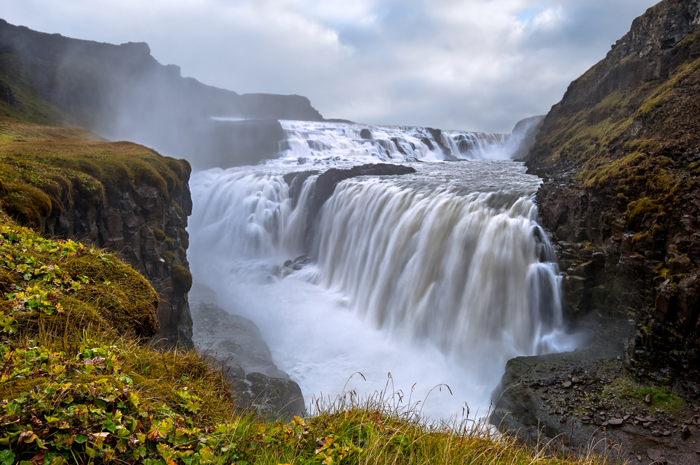 deep in canyon with gullfoss waterfall on a moody day