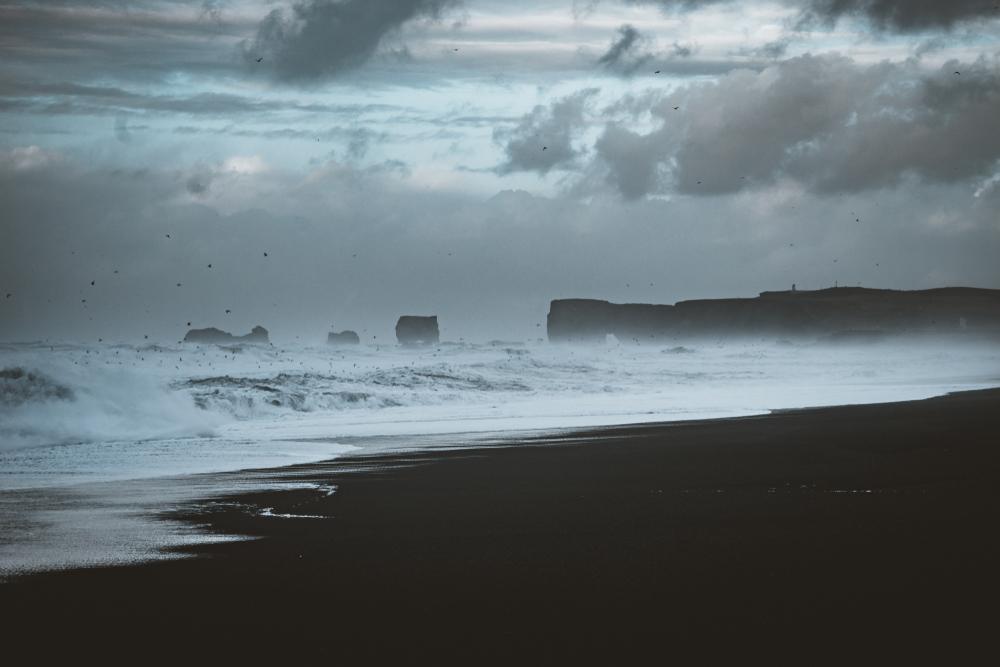 reynisfjara beach in iceland with huge waves