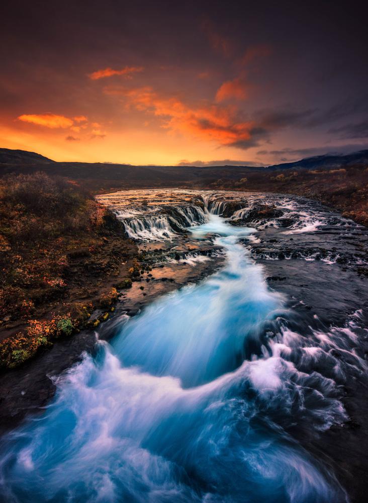 Long exposure photo of Bruarfoss Waterfall at sunset.