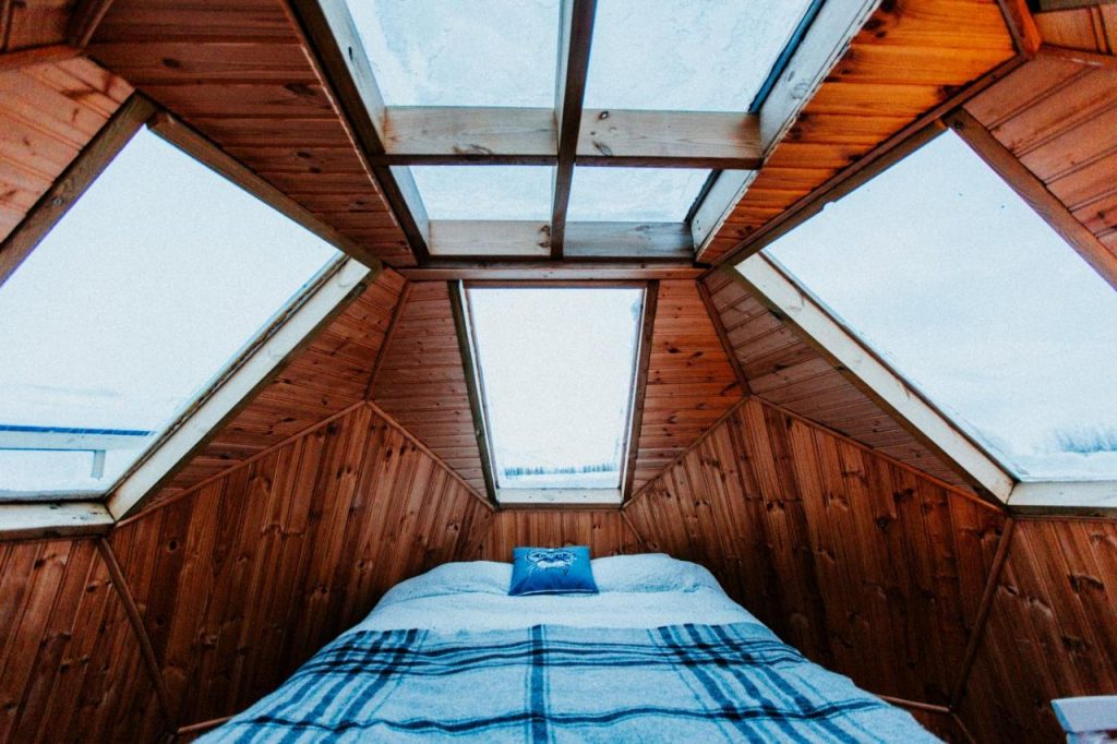 The best place to go glamping in Iceland is the sky sighting igloos where windows showcase big open skies
