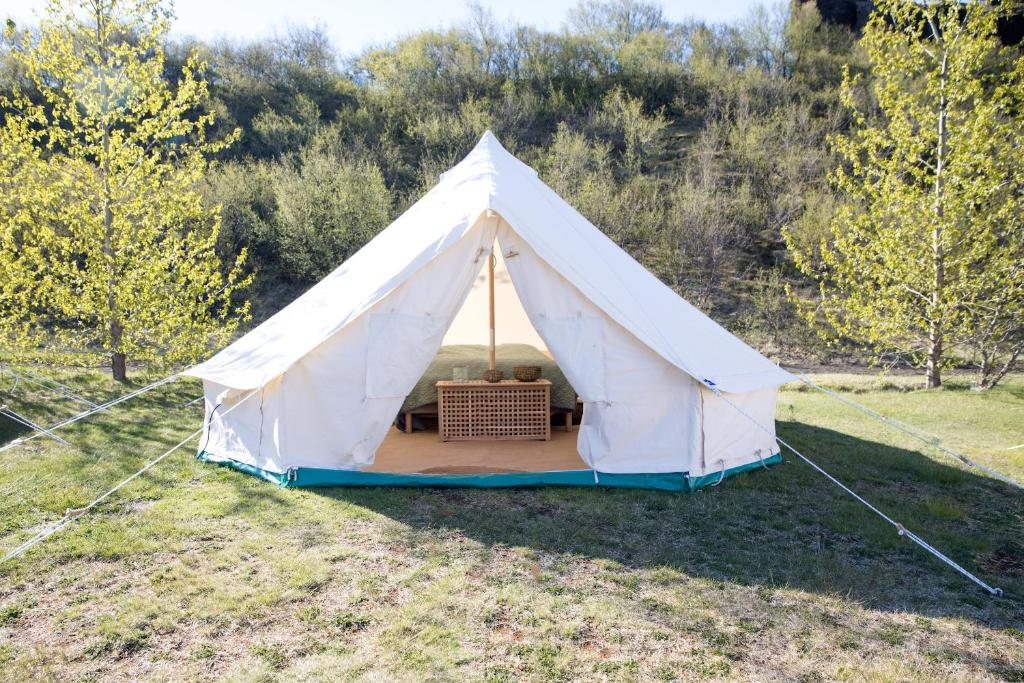 White tent near Thórsmörk nature preserve has the best glamping in Iceland with comfy beds