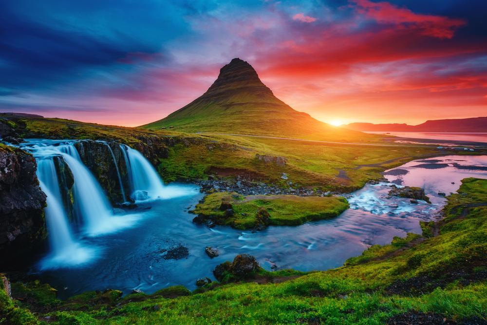 sunset behing Kirkjufell mountain on Snaefellsnes Peninsula in Iceland