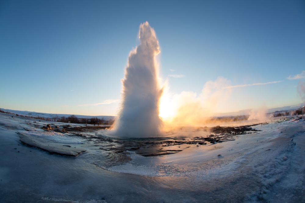 geyser erupting on a winter morning in iceland