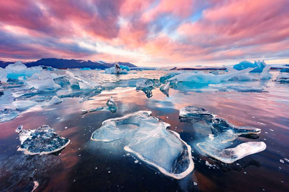 glacial lagoon in iceland at sunset with ice chunks