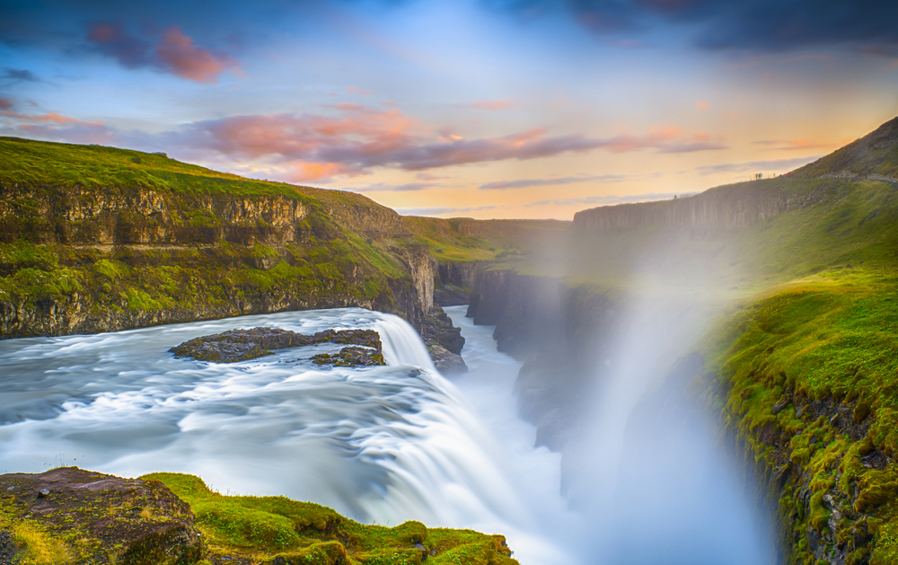 gullfoss waterfall in iceland with mist at sunset