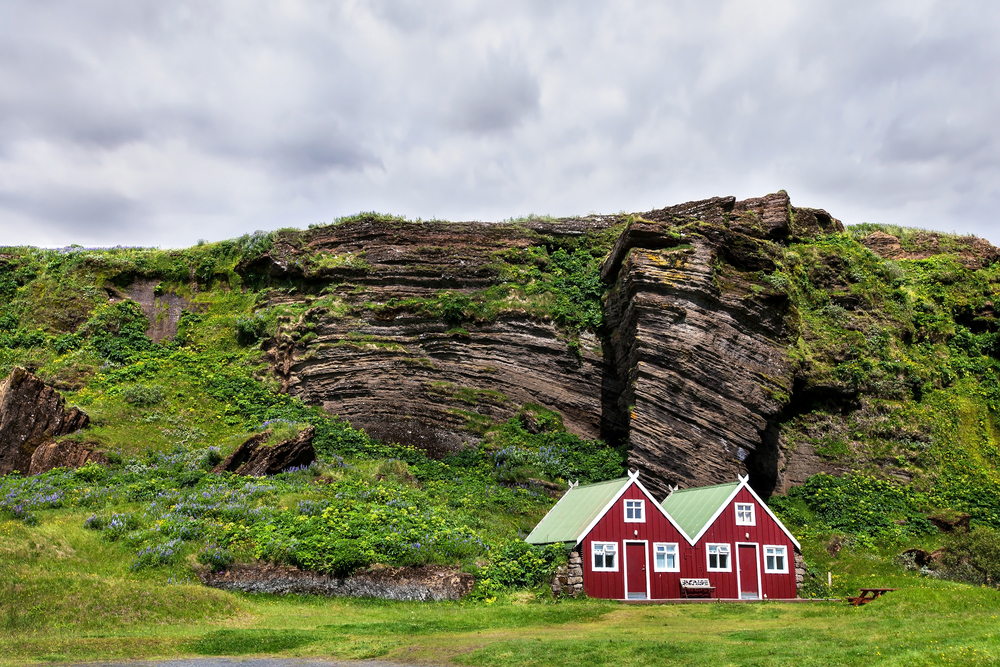 small red cabins in iceland on a sunny day for a stop on a 3 day Iceland itinerary
