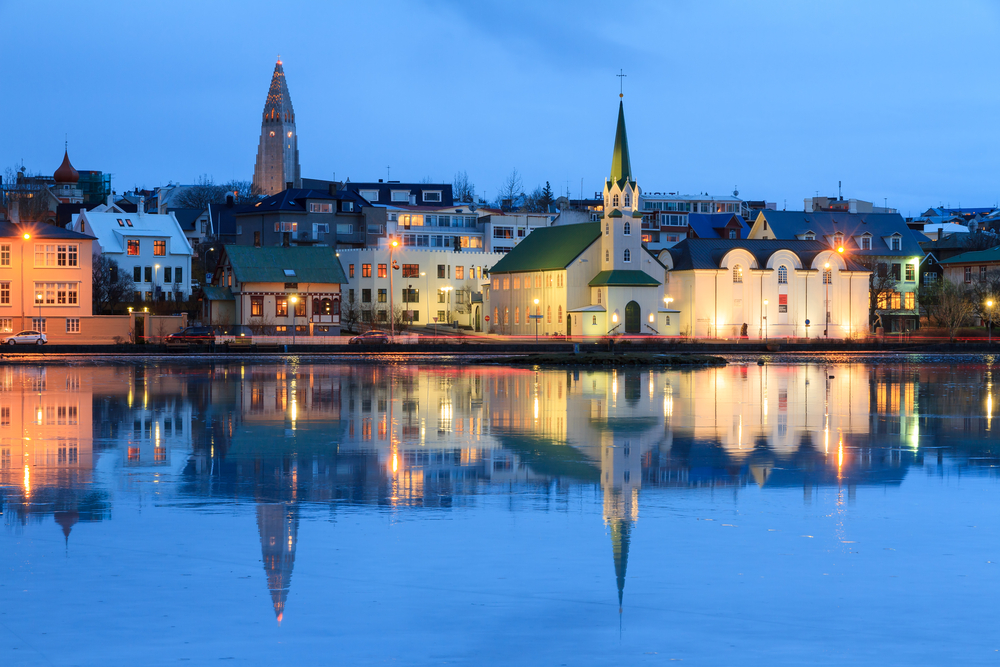 reykjavik at night with water reflection of city as part of a 3 days in Iceland itinerary