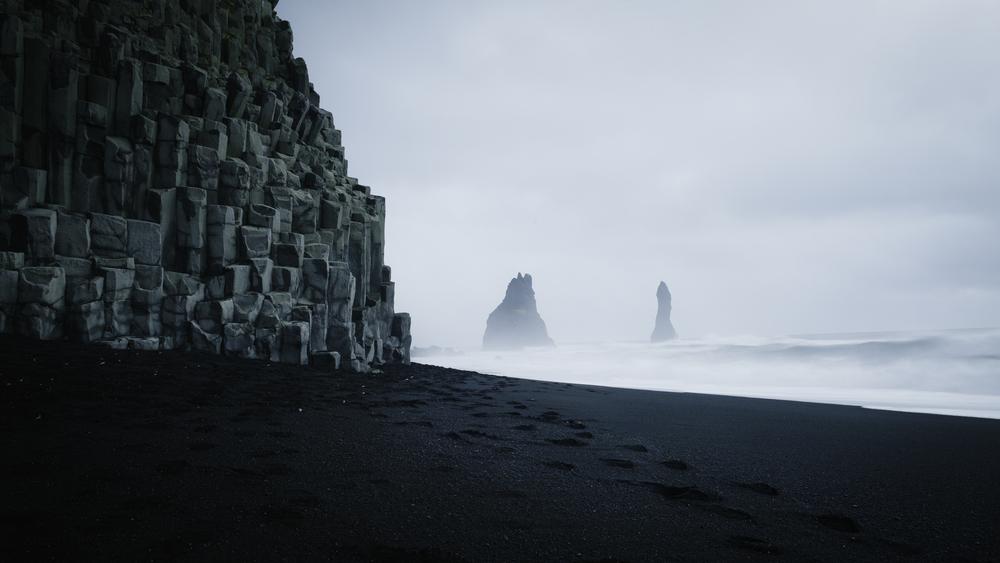 reynisfjara black sand beach on a moody day with waves crashing